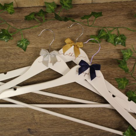 wedding-hangers-white-with-rose-gold-and-bow
