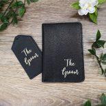 black passport holder and tag
