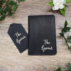 black passport holder and tag
