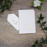 white passport holder and tag