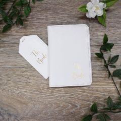 white passport holder and tag
